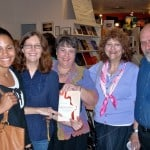 Cousin Marla Krull (center holding book) with members of her husband Hank Radoff's family