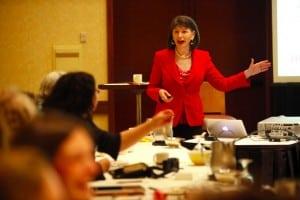 Gloria Feldt presenting at She Negotiates Retreat