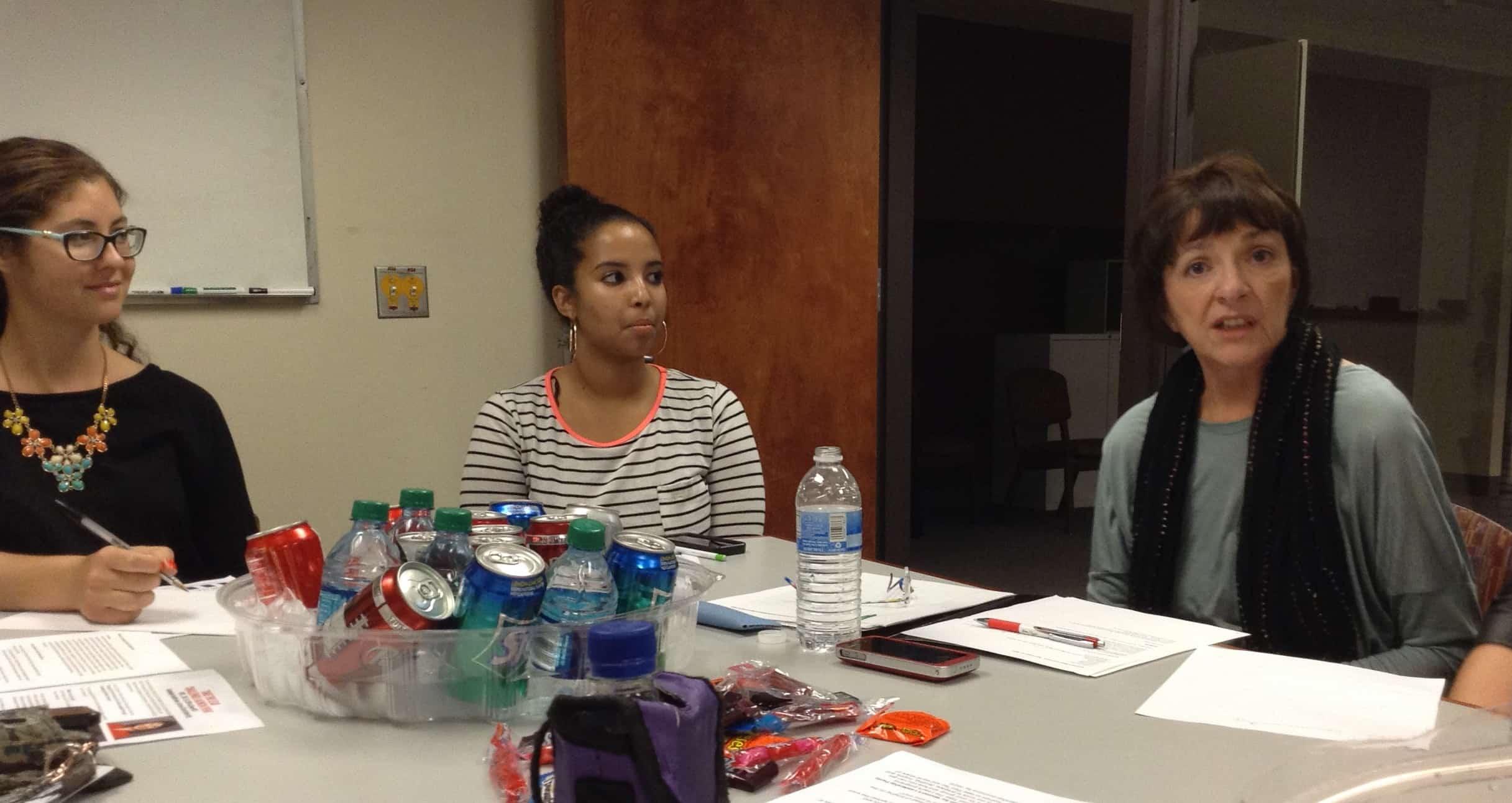 L-R: Lauren Sandground, Rhoda Hassan, Cheryl Swain meet to plan Take The Lead Challenge Feb. 19 launch
